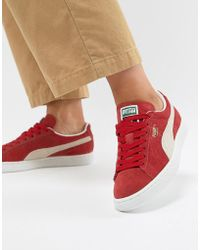 buy online ac294 0e49e PUMA Suede Classic Trainers In Black With Pink Branding in ...