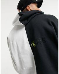 Calvin Klein – Kapuzenpullover mit großem Logo und Blockfarben - Weiß