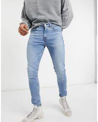 Levi's – Youth 519 Hi Ball– Superenge Jeans - Blau