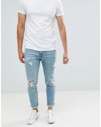 Abercrombie & Fitch - Skinny Fit Destroyed Jeans In Light Wash - Lyst