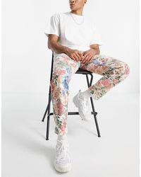 Liquor N Poker ‐ Jeans mit geradem Bein und Blumenmuster - Mehrfarbig