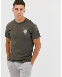 Cheats & Thieves Camiseta con estampado trasero Apache Vibes - Verde