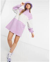 Bershka – gestreiftes pullover-kleid mit reißverschluss vorne - Lila