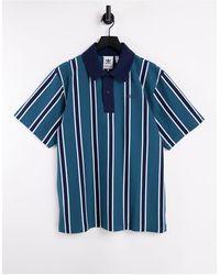 adidas Originals Polo à rayures - bleu