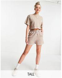 Missguided Shorts para correr marrones con pespuntes a contraste - Marrón