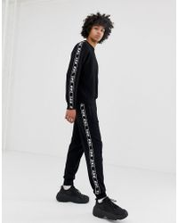 DIESEL K-Suit-A - Pantalon de jogging en molleton avec bandes - Noir
