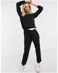 ASOS Hourglass – Trainingsanzug aus Bio-Baumwolle mit Sweatshirt und Jogginghose mit Kontraststreifen - Schwarz