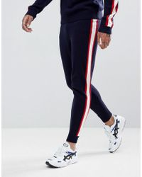 ASOS DESIGN - Knitted Joggers With Side Stripe In Navy - Lyst
