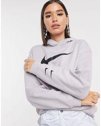 Nike Hoodie oversize à logo virgule - Triple gris