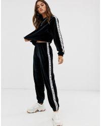 Fiorucci Pantalones de velour con detalle de cintas - Negro