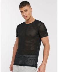 Calvin Klein - Camiseta confort con cuello redondo - Lyst