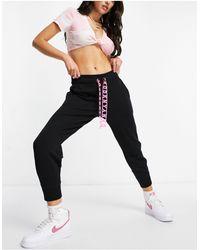 DKNY - Joggers neri con elastico sul fondo e fettuccia con logo - Lyst