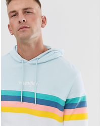 Wrangler Sudadera con capucha con estampado de rayas en azul claro/blanco y arcoíris en el pecho