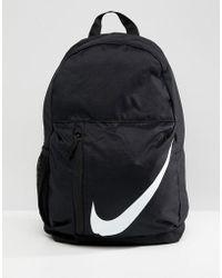 7a877c654b Leopard Print Just Do It Mini Backpack. £17. ASOS · Nike - Black Large  Swoosh Logo Backpack - Lyst