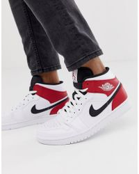 huge selection of a906c 76818 Nike - Nike Air 1 Mid Trainers In White red 554724-116 - Lyst