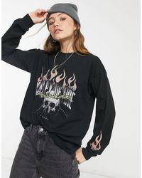 ASOS T-Shirt oversize a maniche lunghe con stampa rock nero slavato