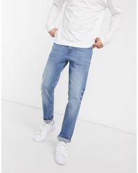 ASOS - Jeans stretch slim lavaggio blu medio - Lyst