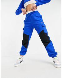 Nike Pantalones cargo azul real y negro Dance