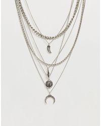 ASOS Collana a strati argento brunito con pendenti assortiti - Metallizzato
