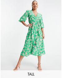 New Look Vestido midi verde cruzado con estampado floral