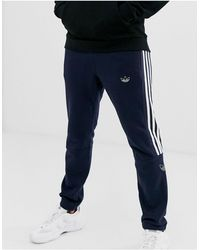 adidas Originals Joggers avec motif trèfle effet contour - Bleu marine