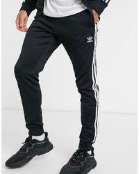adidas Originals Adicolor - Joggers skinny con tre strisce, colore nero