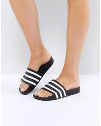 f3ffb41f9dd1f7 Adidas Originals Adilette Slides In Leopard Print Bb3109 in Black - Lyst