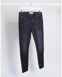 TOPMAN – Super-Spray-On-Jeans - Schwarz