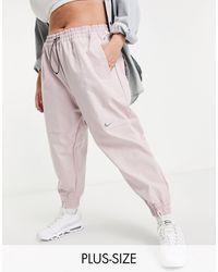 Nike Тканые Штаны Светло-розового Цвета С Логотипом-галочкой Plus-розовый Цвет