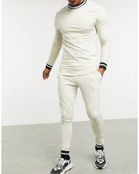 ASOS Survêtement moulant avec bords-côtes à rayures avec sweat-shirt et joggers super ajusté - Neutre
