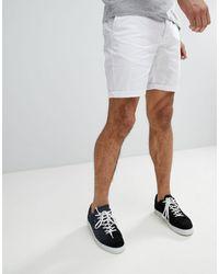 ASOS – Schmal geschnittene Chino-Shorts - Weiß