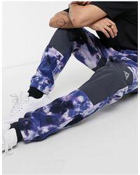 Huf Pantalones violetas con estampado en toda la prenda - Morado