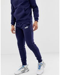 PUMA Skinny Fit Joggers In Navy - Blue