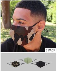 ASOS Lot de 3 masques en tissu à brides ajustables et clip pour le nez avec imprimé camouflage - Noir