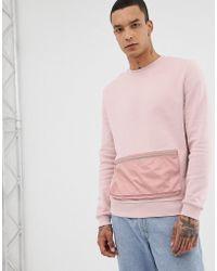 ASOS Sudadera con bolsillo tejido en rosa