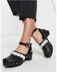 ASOS – Talent – Leder-Clogs - Schwarz