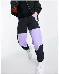 adidas Originals - Adventure - Joggers color block viola chiaro - Lyst