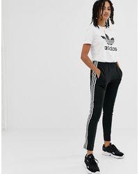 adidas Originals Adicolor - Pantalon cigarette à trois bandes - Noir