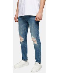 TOPMAN Jean skinny en coton biologique mélangé extensible avec déchirures - Délavage moyen - Bleu