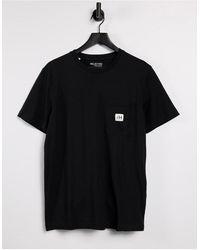 SELECTED - T-shirt nera con tasca con logo - Lyst
