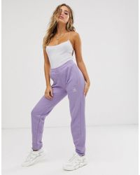 Adicolor Three Stripe Cuffed joggers In Lilac Purple
