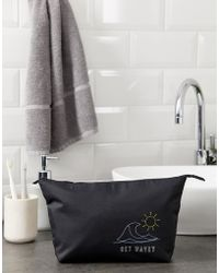 ASOS Wash Bag In Black With Get Wavey Embroidery