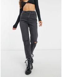 Object – Jeans mit abgestuftem Taillenbund und Zierrissen - Schwarz