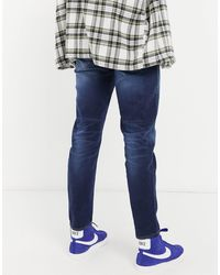 ASOS Tapered Jeans With Sustainable 'less Thirsty' Wash - Blue