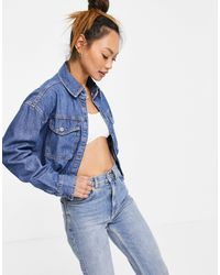 WÅVEN WÅVEN – Jeansjacke mit kurzem Schnitt aus verwaschenem Indigo-Denim - Blau
