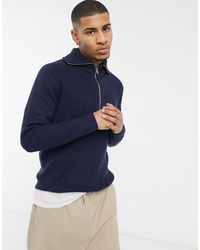 Another Influence Jersey azul marino con cuello alto y media cremallera