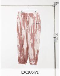 Reclaimed (vintage) Joggers en color óxido con lavado teñido anudado - Rojo