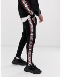 Converse Sweatpants With Taped Side Stripes In Black 10006733 A09