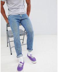 Wrangler - Slider Tapered Jeans Stone Blue - Lyst