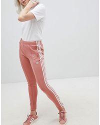 Le adidas originali i pantaloni della tuta e tuta da 54